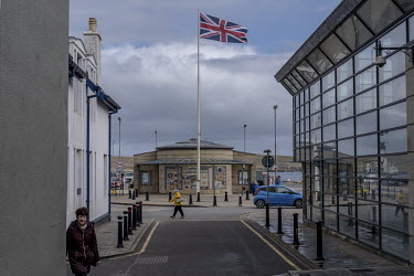A Union Jack flies above the harbour at Lerwick. With a population of around 7,000, Lerwick is the biggest town in the Shetland Islands which have a total population of around 22,000. In 2020 the Shet...
