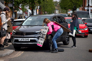 A lone woman climate protestor who was sitting in the middle of Abbeyville Road in Clapham taking part in an Extinction Rebellion 'Rebellion of One' action confronts the driver of a vehicle who was tr...