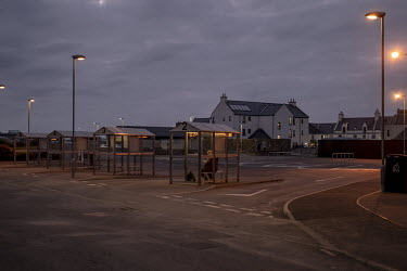 A man waits in the bus station at Kirkwall, the main town in Orkney.