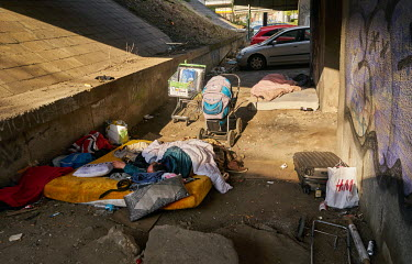 Honza, a homeless man, sleeps on a mattress under an overpass in Prague's Balabenka district. He said that the police have told him that he and his two friends�must leave this place at the end of th...
