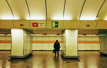 A woman waits for a train in at Invalidovna metro station.�