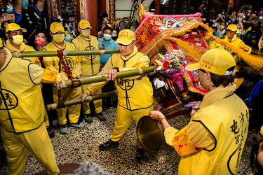 Temple workers start swining the palanquin bearing the ancient goddess Mazu diety as it is set to depart the 200 year-old Taoist (Daoism) Gongtian Temple on its 200km route south. The temple has hoste...