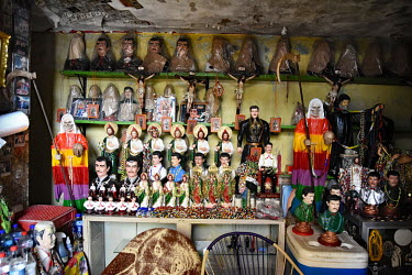 A stall selling Christian and drug cartel related souvenirs including statuettes of Jesus and Joaquin 'El Chapo' Guzman.