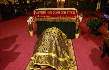 Priest Jan Polansky bows before a picture of Jesus Christ on a Holy Shroud in St. Ann's Church.