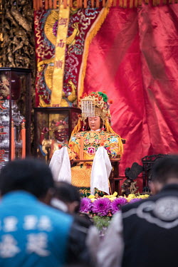 A statue of the goddess Mazu deity inside the 200 year old Taoist (Daoism) Gongtian Temple from where a palanquin carrying the deity will set off on a 200km pilgrimage route accompanied by many follow...