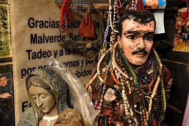 A shop selling Christian and drug cartel related souvenirs including statuettes of the virgin mary and Joaquin 'El Chapo' Guzman.