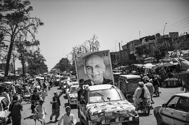 Supporters of Afghan presidential candidate Ashraf Ghani take part in a parade through the streets of Herat.