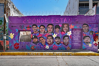 A wall mural featuring portraits of some of the disappeared people from the region with the slogan 'where are they'.