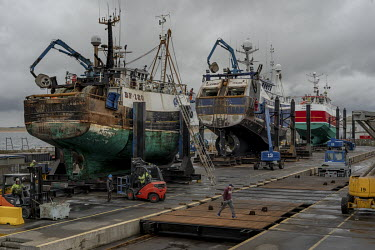 Trawlers undergoing repairs at the port of Fraserburgh, one of the UK's main ports for whitefish.