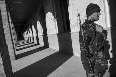 An Afghan National Army (ANA) soldier walks though the Darul Aman Palace. The palace, originally built in the 1920s, has been damaged on many occasions during years of unrest and war in Afghanistan. T...