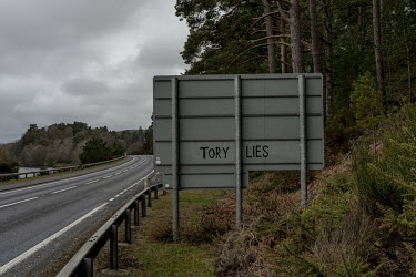 Anti-government graffiti on the back of a traffic sign in the Scottish Highlands.