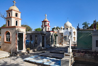 The Jardines de Humaya, a cemetery where many drug barons are buried. Even in death they try to outdo each other with pompous mausoleum architecture, some even three stories high.