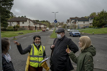 Roza Salih (left) with Scottish National Party (SNP) MP Chris Stephens and SNP volunteers as they post leaflets in a Glasgow suburb for the May 2021 Scottish Parliament elections.  Roza is an Iraqi Ku...