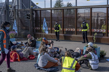 Environmental activists blockade the north gate at Faslane naval base to protest against the Trident nuclear submarines that are stationed there. The Scottish National Party has vowed to get rid of Tr...