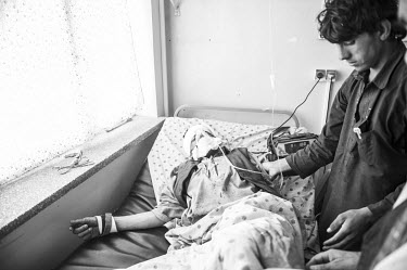 A man injured in a Taliban attack is treated in Mirvays Hospital May. After the start of their annual spring offensive across the country, hundreds of Taliban militants have begun to try and overrun s...