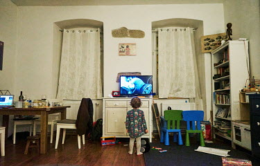 Tonicka (4) watching a fairytale on TV. Tonicka's mother is dental hygienist�and father is a dentist. Both parents could work during the recent coronavirus lockdown, but her kindergarten�was close...
